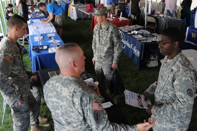 "Soldiers seek education resources beneath ""ed center's"" big top"