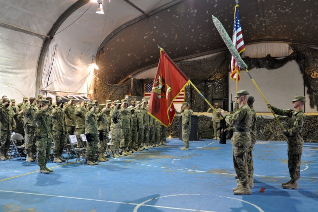 More than 250 Soldiers salute the colors during the 257th Movement Control Battalion transfer of authority ceremony on July 18, 2012 at Bagram Airfield. The 257th MCB transferred authority to the 49th MCB, who will take over joint movement control operations in Bagram and Kandahar. (U.S. Army photo by Sgt. Gregory Williams)