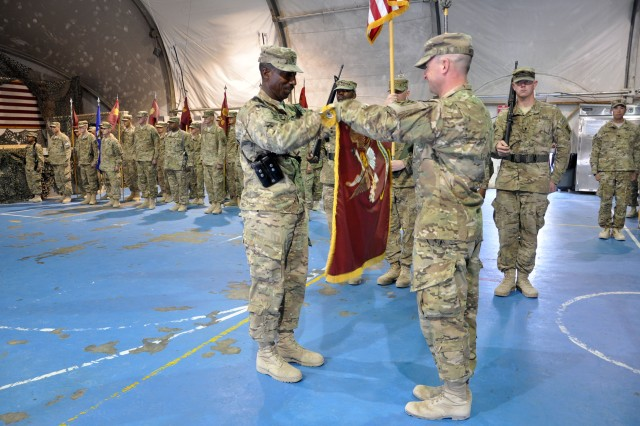 Command Sgt. Maj. James C. Vickers, the senior enlisted leader for the 257th Movement Control Battalion (left) and Lt. Col. Kevin F. Meisler, commander of the 257th MCB, prepare to case the colors during a transfer of authority ceremony on July 18, 2012 at Bagram Airfield.The 257th MCB transferred authority to the 49th MCB, who will take over joint movement control operations in Bagram and Kandahar (U.S. Army photo by Sgt. Gregory Williams)