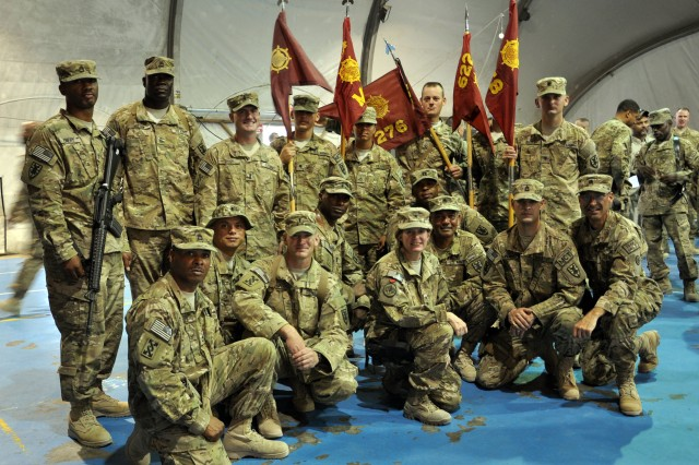 "Brig. Gen. Kristin K. French, commanding general, Joint Sustainment Command "" Afghanistan (bottom middle), talked and posed for photos with Soldiers from different movement control teams on July 18, 2012 at Bagram Airfield. Soldiers from the movement control teams attended the 257th MCB transfer of authority ceremony as guidon bearers for their units. (U.S. Army photo by Sgt. Gregory Williams)"