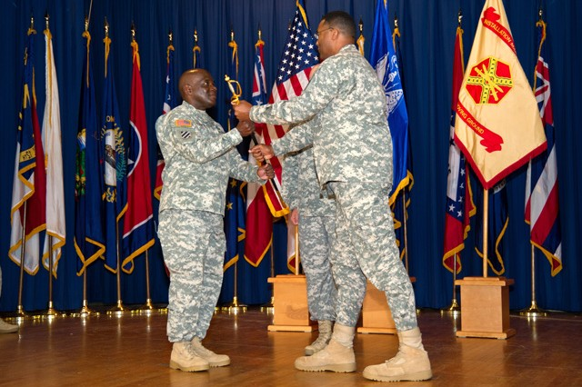 (From left) Incoming APG Garrison Command Sgt. Maj. James E. Ervin receives the noncommissioned officer's sword from APG Garrison Commander Col. Gregory R. McClinton during the assumption of responsibility ceremony held at the APG North recreation center July 17.
