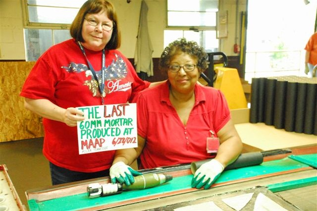 MILAN, Tenn. - (Left to Right) Brenda Ballard and Annie Thomas, two of the remaining American Ordnance employees at Milan Army Ammunition Plant, performed their production tasks somewhat nostalgically as they passed a 60mm mortar round down the assembly line for the last time on June 28, 2012.