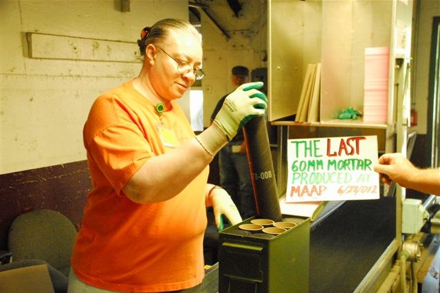 MILAN, Tenn. - Essie Martin, employee of American Ordnance at Milan Army Ammunition Plant, completes the load, assemble, and pack (LAP) process on the final M888 round produced at MLAAP. The plant is currently undergoing a transition to become Milan Commercial Complex.