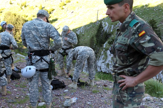 Jesus Chicharro, of the Spanish Army, supervises U.S. Army Cadets as they tighten down their safety gear before starting their training in water crossing along rope bridges that span a river in the Pyrenees Mountains. The Cadets were in Spain as part of U.S. Army Cadet Commands Cultural Understanding Language Proficiency program. CULP is designed to expose Cadets to other cultures so they can see that theirs is not the only one, to form relationships with people in other countries and so the Cadets can gain experience and an understanding of other ways of life. This is the first time ROTC Cadets have traveled to Spain and trained with its military.