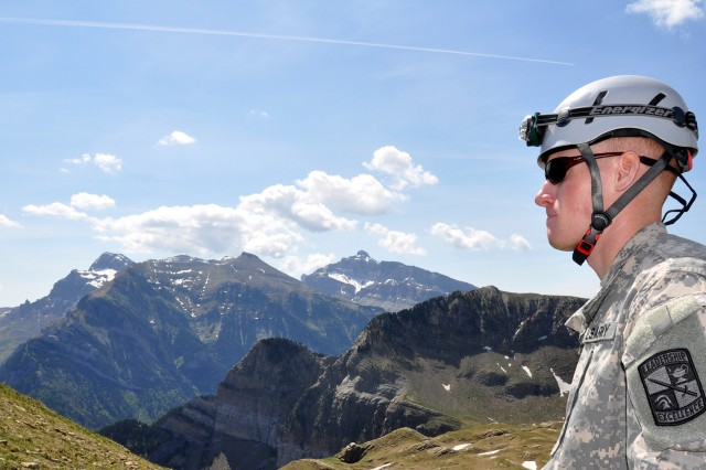 A Cadet looks out over the the Pyrenees Mountains in Spain after having climbed Mount Anayet, which is one of the highest peaks.