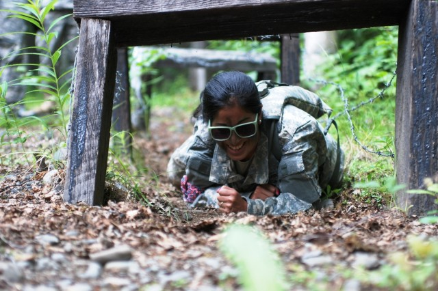 Dominique Ramirez, a 4th Brigade Combat Team (Airborne), 25th Infantry Division spouse,  negotiates an obstacle during the brigade's G.I. Jane Day July 14 on Joint Base Elmendorf Richardson, Alaska. The Soldiers of the 4-25th are currently deployed to Afghanistan and are slated to return to Alaska this fall.