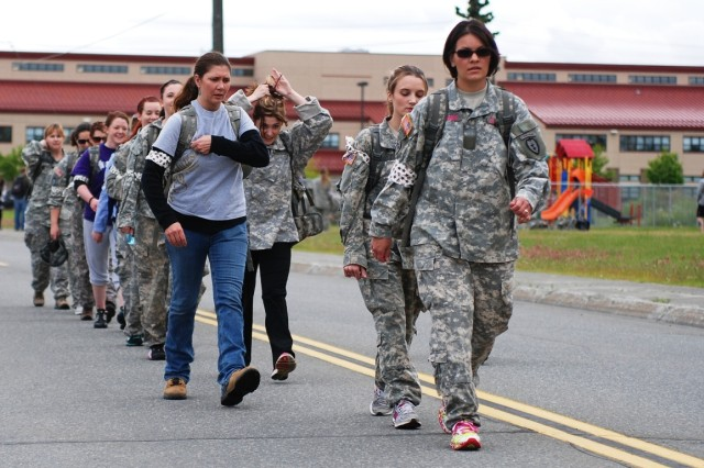 Army spouses of the 4th Brigade Combat Team (Airborne), 25th Infantry Division embark on a 2-mile road march as part of the brigade's G.I. Jane Day July 14 on Joint Base Elmendorf Richardson, Alaska. The Soldiers of the 4-25th are currently deployed to Afghanistan and are slated to return to Alaska this fall.