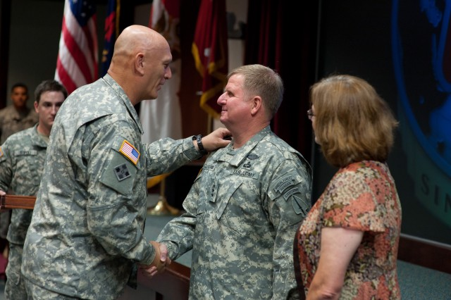 U.S. Army Chief of Staff Gen. Raymond T. Odierno congratulates Lt. Gen. Charles T. Cleveland during his promotion ceremony July 24, 2012, in Fort Bragg, N.C. Cleveland is the new commanding general of the U.S. Army Special Operations Command.