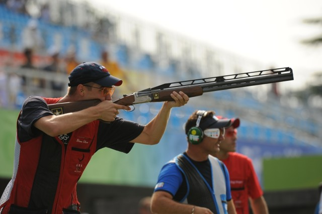 Spc. Walton Glenn Eller III takes his final shot to secure a gold medal with an Olympic record score of 190 in double trap in Beijing.