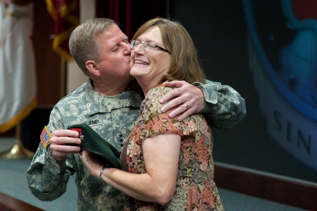 U.S. Army Lt. Gen. Charles T. Cleveland kisses his wife Mary Ann during his promotion ceremony July 24, 2012, in Fort Bragg, N.C. Cleveland is the new commanding general of the U.S. Army Special Operations Command.