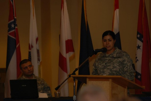 Spc. Badia Oulim, 51st Translator Interpreter Company, speaks to audience members about her experiences as a Muslim U.S. Soldier and immigrant during Fort Irwin's Celebration of Unity during Ramadan at Sandy Basin Community Center, Fort Irwin, Calif., July 18, 2012.