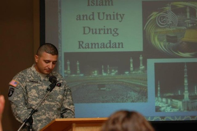 Sgt. Senan Zangana, 51st Translator Interpreter Company, speaks to audience members about his experiences as a Muslim U.S. Soldier and immigrant during Fort Irwin's Celebration of Unity during Ramadan at Sandy Basin Community Center, Fort Irwin, Calif., July 18, 2012.