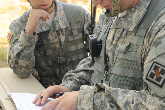 Sgt. 1st Class Michael Schaub, assigned to 388th Route Clearance Company, 841st Engineer Battalion, 926th Engineer Brigade, 412th Theater Engineer Command, makes calculations at the demolition range during River Assault 2012, at Fort Chaffee, Ark. Schaub was the Range Safety Officer during the three-day event, ensuring soldiers handled all explosive material safely.