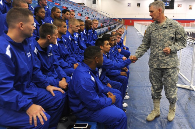 Lt. Gen. Don Campbell Jr., III Corps and Fort Hood commanding general, meets with the III Corps Combatives Team, July 24, 2012, inside Abrams Physical Fitness Center before the 2012 Army Combatives Championship.