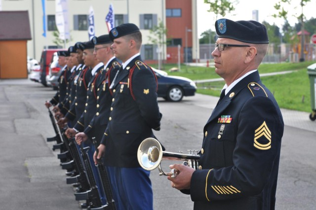 Sgt. 1st Class Richard J. Runge, a native of Bothell, Wash., and trumpet player of the 204th Army Band, stands by to play Taps July 11, 2012, during a memorial ceremony in honor of Sgt. Mathaniel J. Corser of the 172nd Infantry Brigade in Grafenwoehr, Germany. Runge augmented the 85th Army Band while the unit conducted overseas duty training.