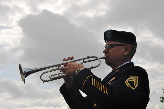 Sgt. 1st Class Richard J. Runge, a native of Bothell, Wash., and trumpet player of the 204th Army Band, prepares for a memorial ceremony, July 11, 2012, in honor of Sgt. Mathaniel J. Corser of the 172nd Infantry Brigade in Grafenwoehr, Germany. Runge augmented the 85th Army Band while the unit conducted overseas duty training.