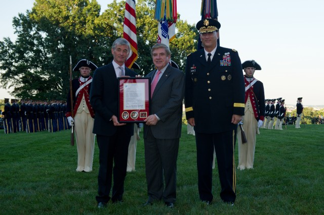 Secretary of the Army John McHugh and Army Chief of Staff Gen. Raymond T. Odierno present a letter of recognition to Sen. Ben Nelson for his steadfast support to the Department of the Army during a tribute to retiring members of Congress at Whipple Field on Joint Base Myer-Henderson Hall, Va., July 25, 2012.
