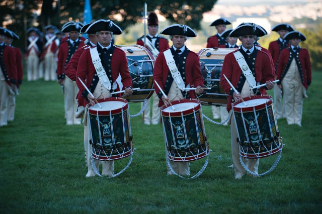 """Soldiers from the Fife and Drums Corps, 3rd Infantry Regiment """"Old Guard,"""" perform during Twilight Tattoo at Whipple Field on Joint Base Myer-Henderson Hall, Va., July 25, 2012."""