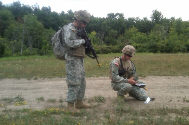 FORT DRUM New York Army National Guard Pvt 1st Class John Baez and SPC Charles Smith , both members of Company A 101st Expeditionary Signal Battalion, plot their next point during land navigation conducted here on July 20. The Soldiers are preparing to deploy to Afghanistan later this year.