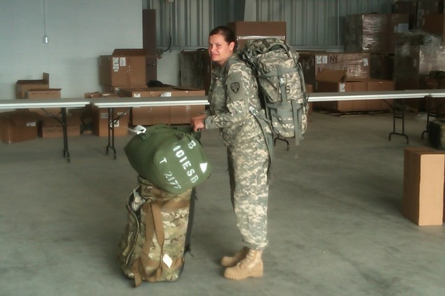 FORT DRUM--New York Army National Guard Sgt. Krystal Tesoriero, a member of the 101st Expeditionary Signal Brigade,  draws deployment gear from the Central Issue Facilty as premobilization training begins here on Saturday, July 15. The Soldiers are preparing to deploy to Afghanistan later this year.