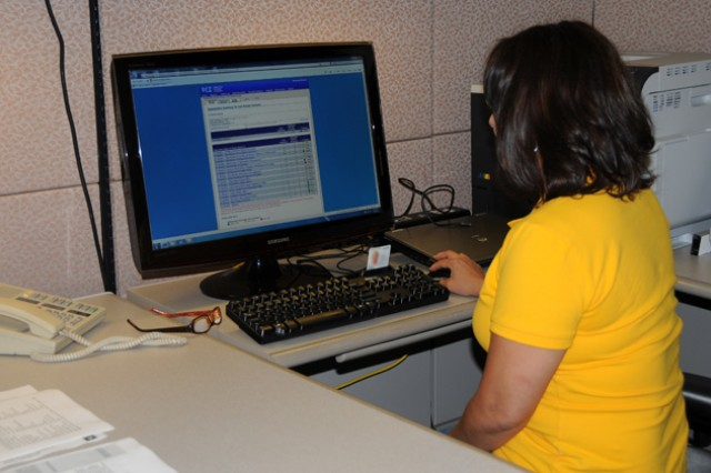Christie C. Pollard, management analyst for the plans, analysis and integration office looks at the online Interactive Customer Evaluation website.