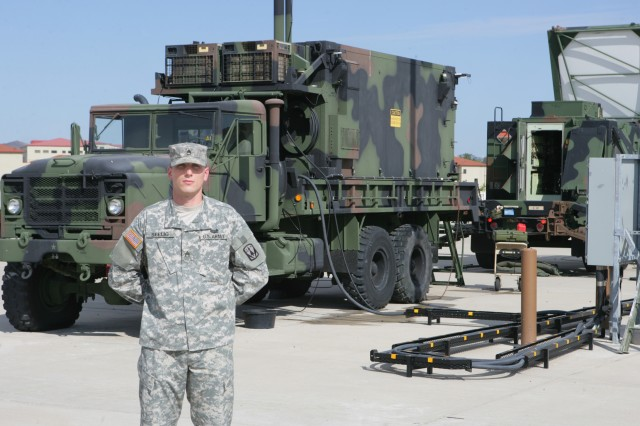 Staff Sgt. Matthew Seelig, 31st Air Defense Artillery Brigade, stands before a Patriot radar, engagement control station. Selig, who supervises 65 Soldiers and is responsible for $19.5 million in equipment was named the runner up NCO of the Year by Forces Command.