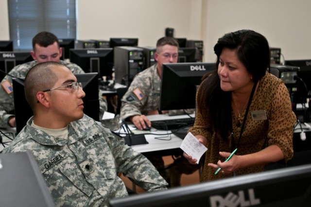 May Burnett, an education services representative, helps Soldiers access GoArmyEd during an introduction class on Joint Base Lewis-McChord, Wash., July 18. The website is a virtual portal to allow Soldiers to manage their education records and request tuition assistance.
