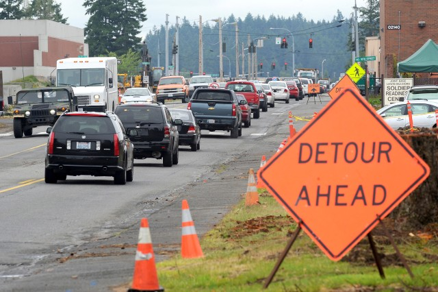 Detour signs direct traffic along Pendleton Avenue on Joint Base Lewis-McChord. When construction is completed, the avenue will be a tree-lined boulevard with a planted median and bike paths on either side.