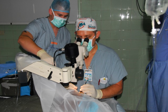 U.S. Army Ophthalmologist providing care to Dominicans, working with host nation doctors