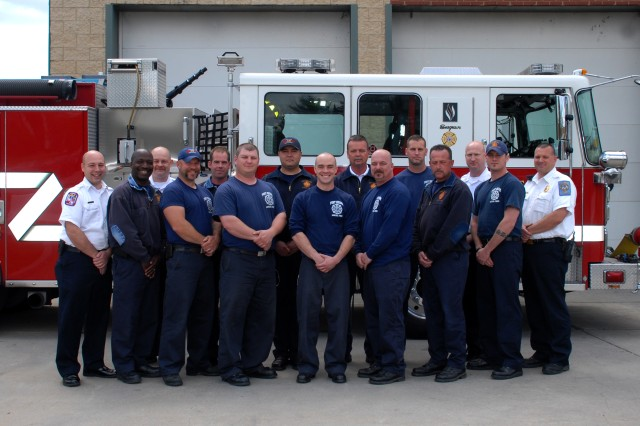 Members of the Fort Meade Department of Fire and Emergency Services stand outside the firehouse. The 43-member department was recently named the Department of the Army's Small Fire Department of the Year for 2011 after winning the Installation Management Command competition on May 23.