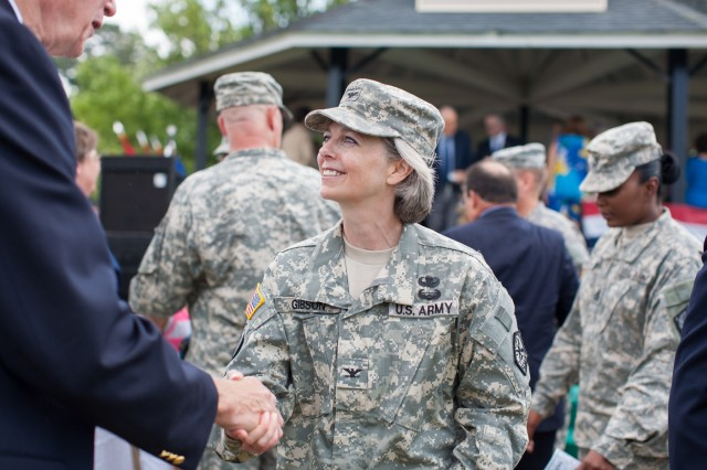 Col. Karen H. Gibson, outgoing commander of the 704th MI Brigade who is deploying to Afghanistan, is greeted by retired Col. G. Dickson Gribble Jr., a former commander of the brigade, following the change of command ceremony Tuesday.