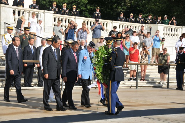 Leaders, including the Korean Ambassador to the U.S., Choi Young-Jin and Defense Secretary Leon Panetta, lay a wreath at the Tomb of the Unknown Soldier in Arlington National Cemetery, to honor service and sacrifice of veterans of the Korean War, July 27, 2012. Attendees, including those on the balcony above include: Secretary of Veterans Affairs Eric K. Shinseki, former Army chief of staff; Secretary of Transportation Ray LaHood; Secretary of the Army John M. McHugh; Gen. Robert W. Cone, commander, U.S. Army Training and Doctrine Command; Lt. Gen. William Troy, director of the Army Staff; Gen. Craig R. McKinley, chief of the National Guard Bureau; Sgt. Maj. of the Army Raymond F. Chandler III; retired Army Sgt. 1st Class Ronald E. Rosser, Korean War veteran and Medal of Honor recipient; Cpl. Rodolfo P. Hernandez, a former Soldier, Korean War veteran and Medal of Honor recipient; and David W. Mills, a former Soldier and Korean War veteran. Many Soldiers and other veterans and their families were also among the attendees.