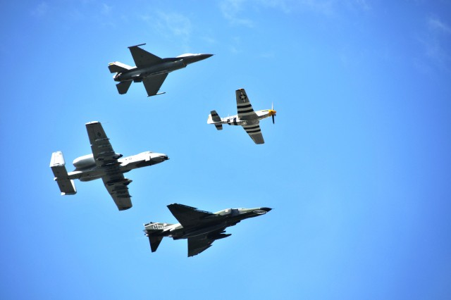 A formation of Korean War-era aircraft flies over Memorial Amphitheater in Arlington National Cemetery, July 27, 2012. Commemoration ceremonies were held, marking the 59th anniversary of the signing of the armistice that ended fighting on the Korean Peninsula, July 27, 1953.