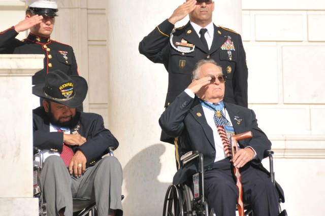 Korean War veterans, former Soldiers and Medal of Honor recipients retired Army Sgt. 1st Class Ronald E. Rosser (right) and Cpl. Rodolfo P. Hernandez, pay respects to their fallen comrades during the wreath laying ceremony at the Tomb of the Unknown Soldier in Arlington National Cemetery, July 27, 2012. Commemoration ceremonies were held, marking the 59th anniversary of the signing of the armistice that ended fighting on the Korean Peninsula, July 27, 1953.