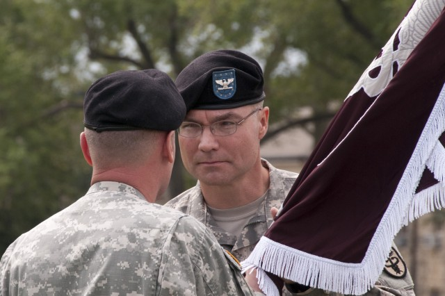 Colonel Barry Pockrandt (right) receives unit colors from Brig. Gen. Dennis Doyle and becomes commander of Irwin Army Community Hospital during a change of command ceremony July 13 at Cavalry Parade Field.