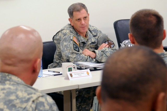 "Lt. Gen. Michael Ferriter, commander of Installation Management Command, speaks to 1st Infantry Division company commanders during a sensing session July 27, 2012, at Fort Riley, Kan. Ferriter was one of eight senior Army leaders who spoke with Fort Riley Soldiers and personnel about everything from programs, services, resources and best practices pertaining to the health of the force. The stop was the last in a six-installation tour to assess the ""health of the force."""