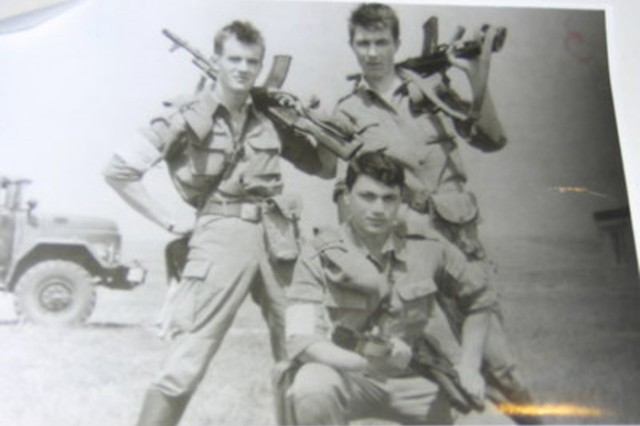 Cpl. Vitalis Dubininkas (left) shows off with his friends while in the Soviet Army in 1991. Dubininkas participated in Operation River Assault 2012 and is currently the Team leader for 3rd Platoon, 316th Engineer Mobility Augmentation Company, 844th Engineer Battalion, 926th Engineer Brigade, 412th Theater Engineer Command.
