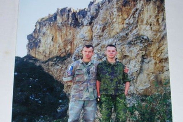 Cpl. Vitalis Dubininkas (left) is shown with translator in former Yugoslavia as part of Operation Joint Endeavor while serving in the Lithuanian Army in 1996.  Dubininkas participated in Operation River Assault 2012 and is currently the Team leader for 3rd Platoon, 316th Engineer Mobility Augmentation Company, 844th Engineer Battalion, 926th Engineer Brigade, 412th Theater Engineer Command.