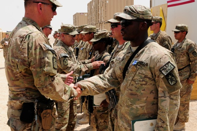 Lt. Col. Paul Dismer, 10th Sustainment Brigade deputy commander, shakes the hand of Spc. Isaiah C. Lowe, a food service specialist assigned to 548th Combat Sustainment Support Battalion, at the completion of an award ceremony. Several Soldiers were recognized for assisting in the completion of Logistics Support Area Lightning at Camp Pratt, Mazar-e-Sharif, Afghanistan.