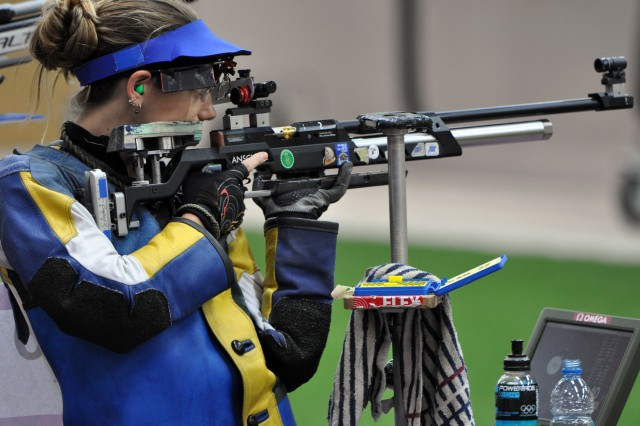 Jamie Gray competes in the 10-meter air rifle match, July 28, 2012, at the Royal Artillery Barracks in East London, the first medal event of the games of the XXX Olympiad. Gray, wife of a U.S. Army Marksmanship Unit Soldier, finished in fifth place overall after scoring a 499.7 in the first of her two Olympic events, three points behind gold medalist Siling Yi of China. She now sets her sights on three-position rifle, which will take place Aug. 4.