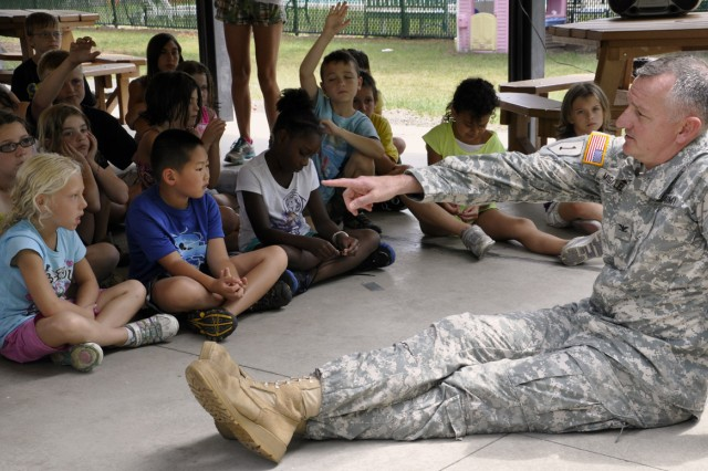 Col. Mark F. Migaleddi, the Watervliet Arsenal commander, fielding tough questioning by the Arsenal's summer camp kids who ranged from 5-14.