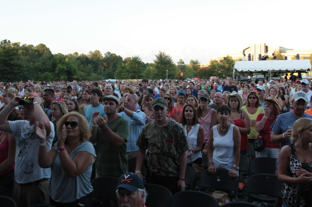 More than 6,500 country music fans cheer for the U.S. Army as 27 Future Soldiers, from the U.S. Army Beckley Recruiting Battalion's Richmond Company, take center stage before an oath of enlistment ceremony July 29 at CountryFest in Glen Allen, Va.