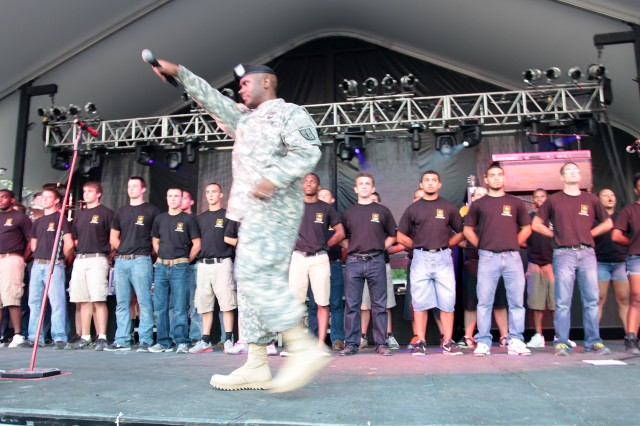 Command Sgt. Maj. Allen B. Offord Jr., the 11th Transportation Regimental command sergeant major, energizes the crowd at CountryFest before an oath of enlistment ceremony on stage with Future Soldiers, from the U.S. Army Beckley Recruiting Battalion, July 29 at the Innsbrook Pavilion in Glen Allen, Va.