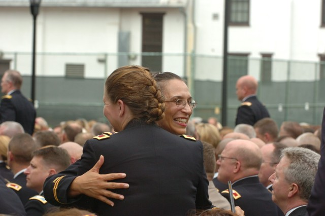 Two Class of 2012 Army War College grads share a hug during the ceremony.