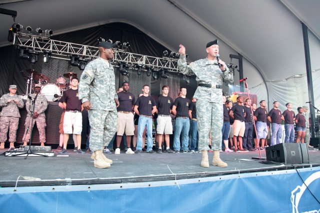 Brig. Gen. Stephen E. Farmen, U.S. Army Chief of Transportation and commandant of Transportation School, introduces his battle buddy, Command Sgt. Maj. Allen B. Offord Jr., the 11th Transportation Regimental command sergeant major, to the more than 6,500 fans at CountryFest July 29 in Glen Allen, Va.