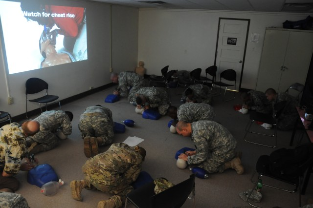 Team Bliss Soldiers and civilians conduct cardiopulmonary resuscitation during their recertification course, July 24. Approximately every five years or so, the American Heart Association changes the CPR guidelines and procedures in order to improve them, requiring medical professionals and others to retrain. (U.S. Army photograph by Sgt. Sean Harriman, 2nd HBCT, 1st AD, Public Affairs)