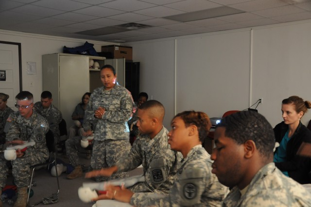 Sergeant Yolanda Santos, a medic in 1st Battalion, 35th Armored Regiment, 2nd Heavy Brigade Combat Team, 1st Armored Division, instructs her first basic life support class after successfully completing her BLS instructor qualifications. Santos is now the only qualified Soldier in the 2nd HBCT, 1st AD, to instruct and recertify the basic life support course required for medical personnel. (U.S. Army photograph by Sgt. Sean Harriman. 2nd HBCT, 1st AD, Public Affairs)