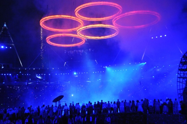 Five Olympic rings rise above the stadium, July 27, 2012, following an Opening Ceremony skit that depicted the industrial revolution heritage of Great Britain. The medal rings were symbolically forged from a foundry in the scene.