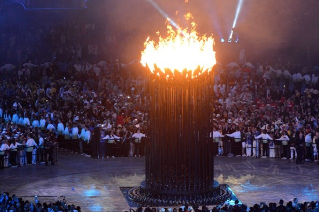 A gigantic flame is lit, July 27, 2012, in the center of Olympic Stadium to begin Olympiad XXX in London following culmination of the torch run.