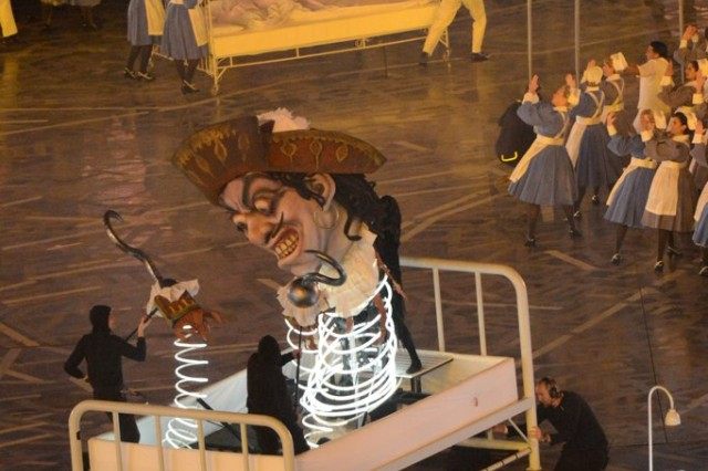 Hundreds of volunteers from the National Health Service participate in a production during the Olympic Opening Ceremony which includes bedtime stories such as Britain's Peter Pan tale represented here by Captain Hook.